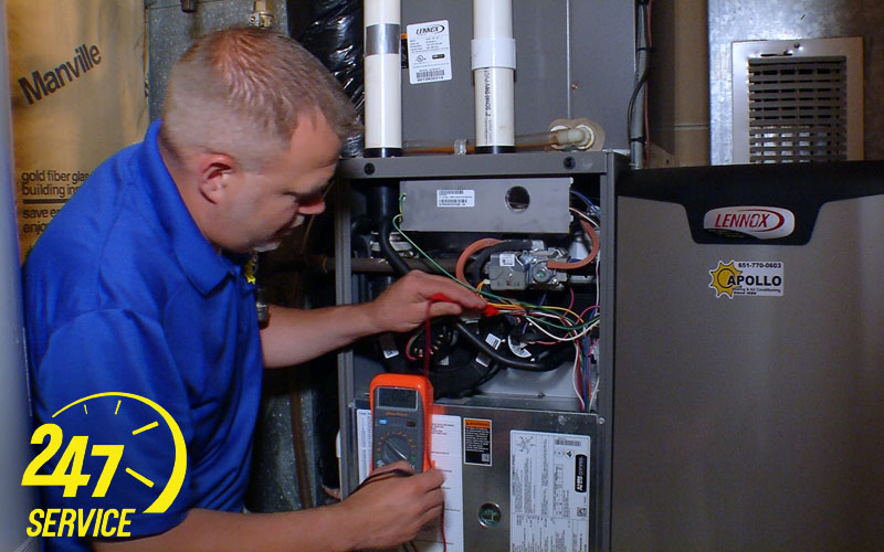 A man performing HVAC repairs in Woodbury, MN